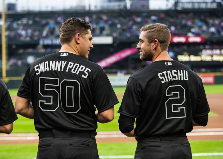 On Friday's uniform, instead of a player's given name, nicknames and symbols were allowed.  Pitcher Erik Swanson, left, and catcher Tom Murphy have their nicknames emblazoned on their backs.  The Toronto Blue Jays played the Seattle Mariners Friday, August 23, 2019 at T-Mobile Park in Seattle, WA. (Dean Rutz / The Seattle Times)
