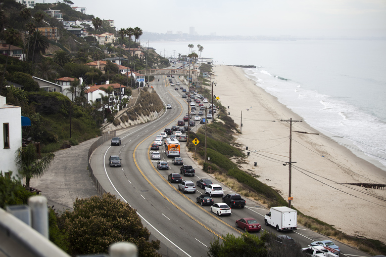 Traffic snakes along the Pacific Coast Highway, Pacific Palisades, Calif. in July. The future of self-driving cars will hinge on how people — drivers and jaywalkers alike — adjust to them. (Jenna Schoenefeld / The New York Times)