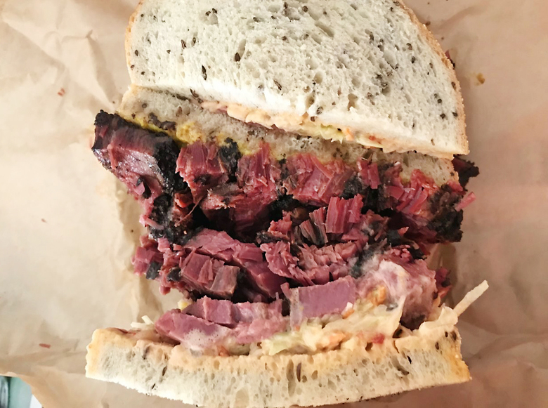 The $19 pastrami on rye at Dingfelder's Delicatessen on Capitol Hill has many fans, but some locals doubt any sandwich is worth this much. (Tan Vinh / The Seattle Times)