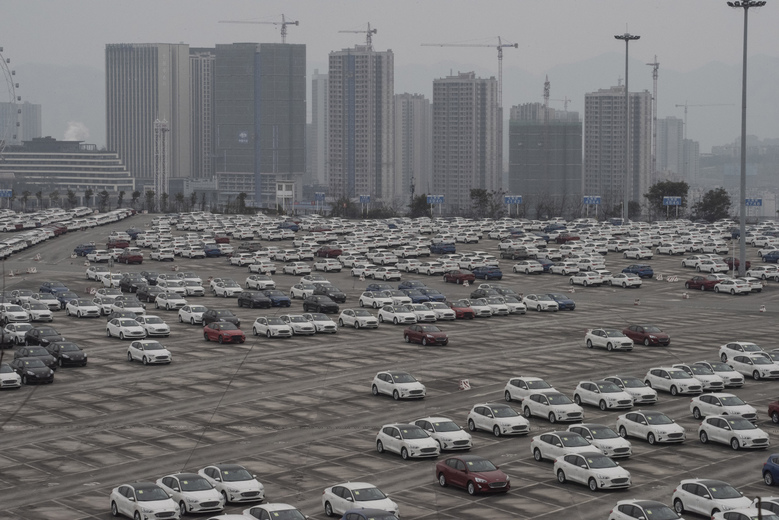 A parking lot where completed Ford models are stored for shipment, in Chongqing, China. With much of the global auto parts industry in China, it is especially convenient to manufacture cars there. China's convenience and its vast and growing consumer market make it difficult for many businesses to abandon China entirely.  (Gilles Sabrié / The New York Times)