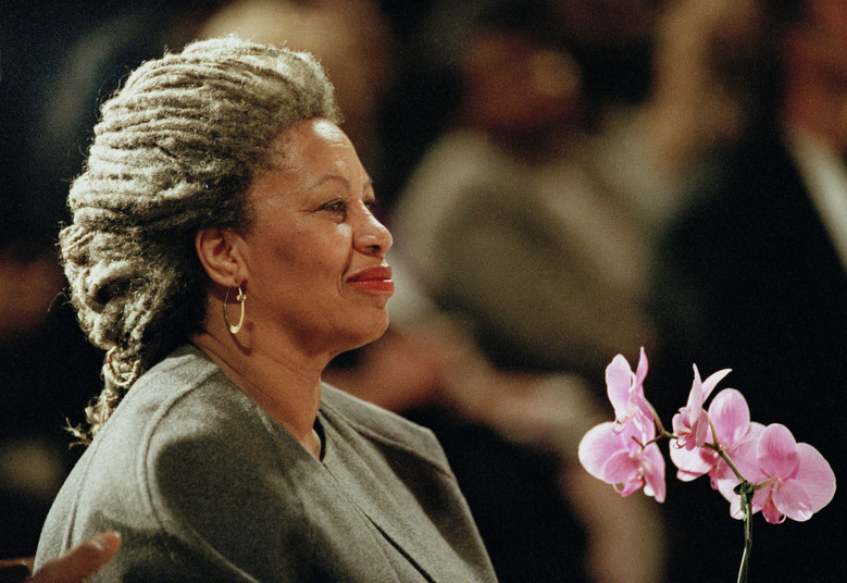 Toni Morrison holds an orchid at the Cathedral of St. John the Divine in New York on April 5, 1994. Publisher Alfred A. Knopf says the author died Monday, Aug. 5, 2019, at Montefiore Medical Center in New York. She was 88. (AP Photo / Kathy Willens)