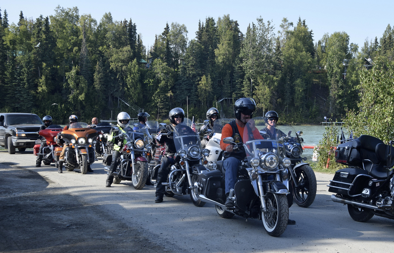 In this Aug. 9, 2019, photo, bikers from the American Legion prepare to escort the soldiers from the Wounded Warriors fishing trip at Centennial Park in Soldotna, Alaska. For members of the military, especially those deployed overseas, vacations can be few and far between. That's where organizations like the Kenai River Foundation have stepped in, to give men and women in uniform a chance to relax and bond while reeling in a few fish. The Kenai River Foundation hosted its 13th annual Wounded Warriors fishing trip over the past weekend and brought 68 active duty soldiers stationed in Alaska down to the peninsula to fish for salmon on the Kenai River. (Brian Mazurek/Peninsula Clarion via AP)
