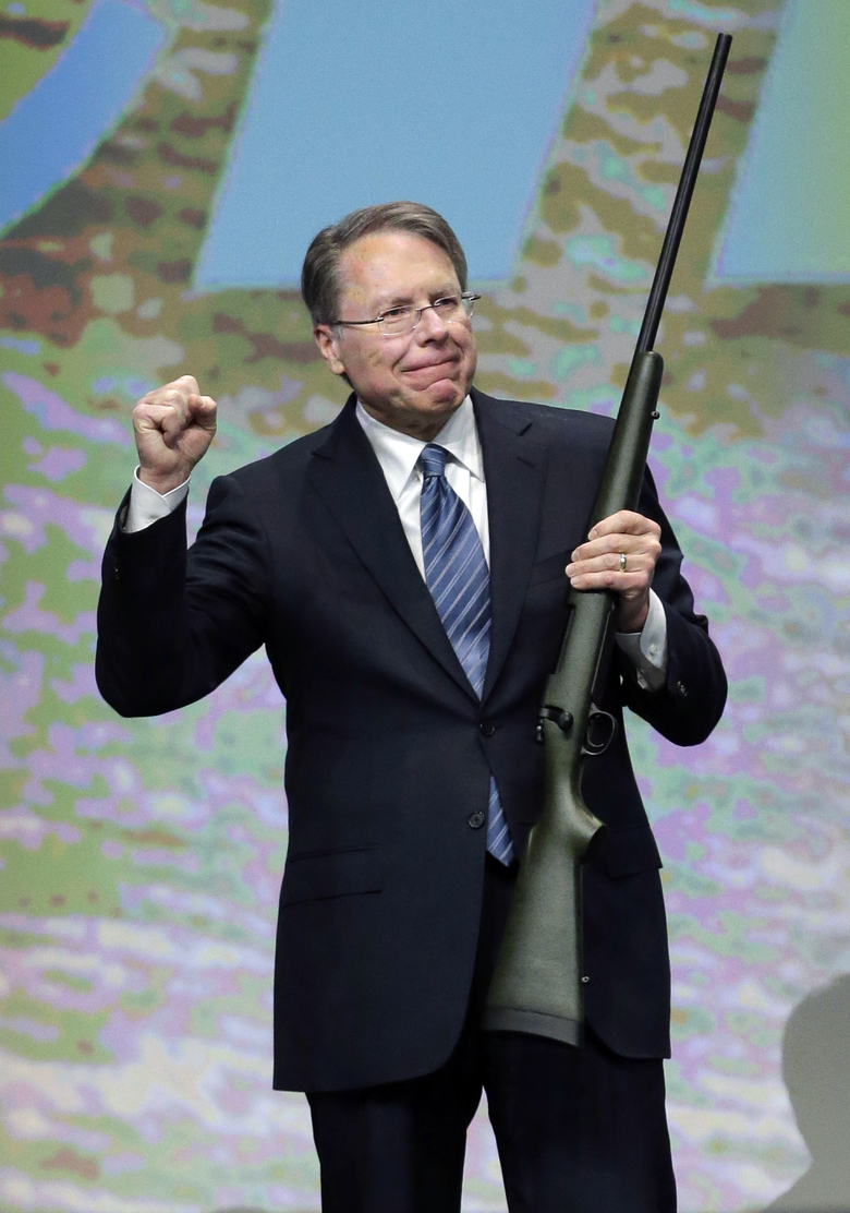 FILE – In this Feb. 23, 2013, file photo, Wayne LaPierre, executive vice president of the National Rifle Association, holds a custom 300 Remington ultra mag during a gun auction after speaking during the Western Hunting & Conservation Expo Banquet at the Salt Palace Convention Center in Salt Lake City. In the latest national furor over mass killings, the tremendous political power of the NRA is likely to stymie any major changes to gun laws. The man behind the organization is LaPierre, the public face of the Second Amendment with his bombastic defense of guns, freedom and country in the aftermath of every mass shooting. (AP Photo/Rick Bowmer, File)
