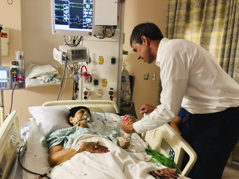 In this image provided by Beto O'Rourke's Facebook page, Presidential candidate and former congressman Beto O'Rourke, right, meets with mass shooting survivor, Rosemary, at University Medical Center in El Paso, Texas on Sunday, Aug. 4, 2019. A gunman opened fire in an El Paso shopping area during the busy back-to-school season Saturday, killing at least a dozen. (Beto O'Rourke Facebook via AP)
