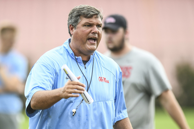 FILE – In this Aug. 9, 2019 ,file photograph, Mississippi head coach Matt Luke talks with offensive linemen during a NCAA college football practice in Oxford, Miss.(Bruce Newman/Oxford Eagle via AP, File)
