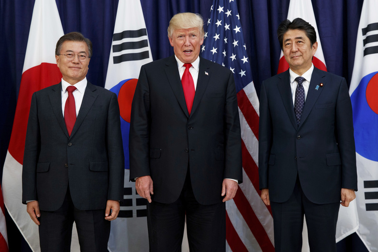 U.S. President Donald Trump, center, meets with Japanese Prime Minister Shinzo Abe, right, and South Korean President Moon Jae-in in 2017. In August 2019, Trump angered some Asian American voters after the New York Post reported that he mocked the accents of Moon and Abe at a fundraiser in the Hamptons. (AP Photo/Evan Vucci, File)