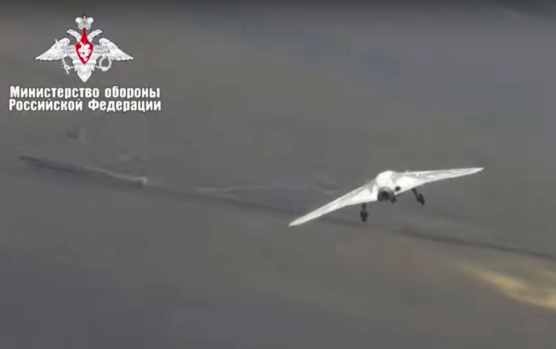 In this video grab made available on Wednesday, Aug. 7, 2019 by Russian Defense Ministry Press Service, Russia's military drone Okhotnik is seen in flight at an unidentified location in Russia. The ministry said the drone, which has stealth capabilities and is equipped with advanced reconnaissance equipment, made its maiden flight Saturday. (Russian Defense Ministry Press Service via AP)