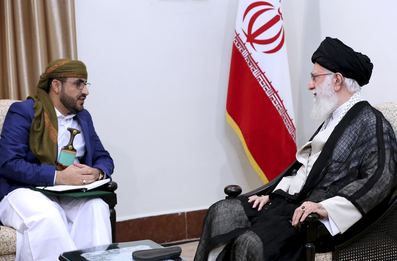 In this picture released by an official website of the office of the Iranian supreme leader, Supreme Leader Ayatollah Ali Khamenei, right, listens to Mohammed Abdul-Salam, spokesman for the Yemen Houthis rebels during their meeting at his residence in Tehran, Iran, Tuesday, Aug. 13, 2019. The Iran-backed Houthis overran Sanaa in 2014. The Saudi-led coalition, backing Yemen's internationally recognized government, has been at war with the rebels, known as Houthis, since 2015, and has imposed a blockade on ports that supply Houthi-controlled areas. (Office of the Iranian Supreme Leader via AP)