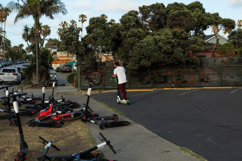 Storefronts, sidewalks and the streets of Mission Beach are inundated with scooters in San Diego, in July. (Tara Pixley / The New York Times)