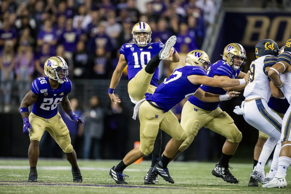 Huskies quarterback Jacob Eason punts the ball on the opening drive as the University of Washington Huskies take on the California Golden Bears at Husky Stadium in Seattle Saturday September 7, 2019. (Dean Rutz / The Seattle Times)