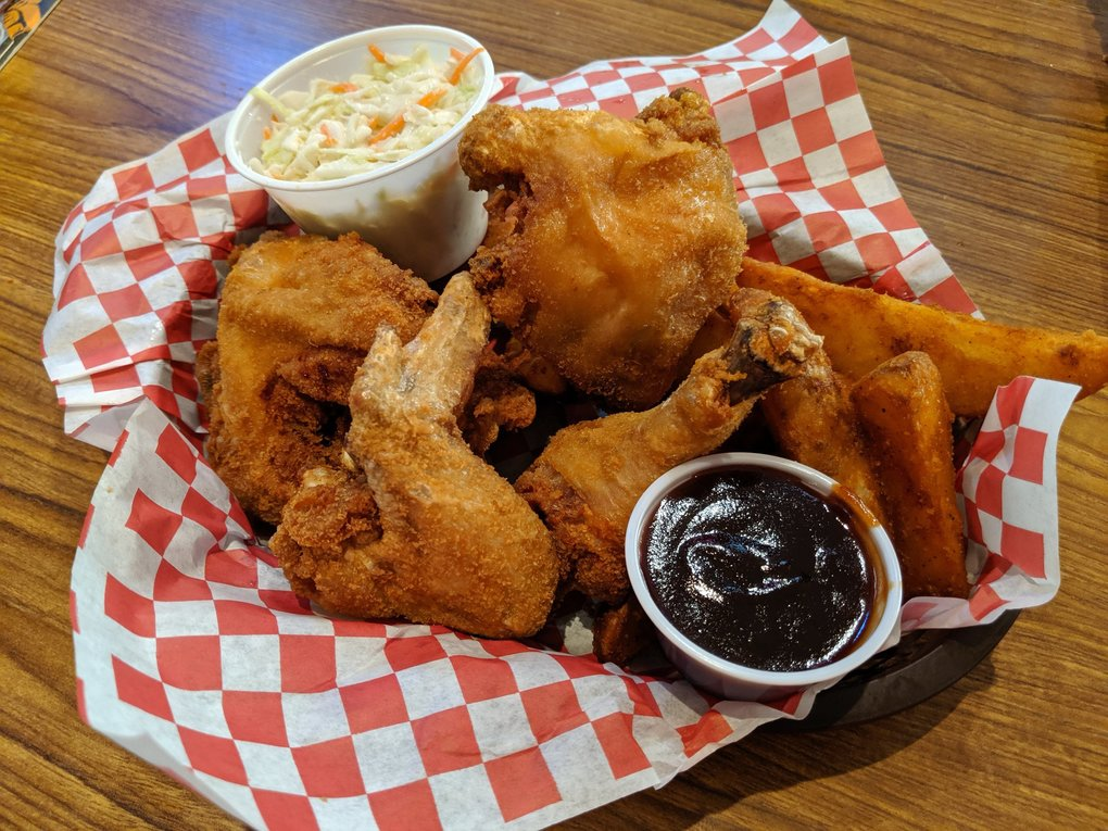 Do not miss ordering the crisp, juicy pressure-cooked chicken at Mustard Seed Grill and Pub, served with a side of coleslaw and jojos. (Jackie Varriano / The Seattle Times)