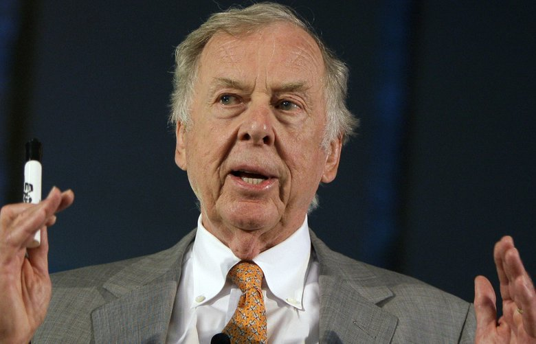 FILE – In this July 30, 2008, file photo, oil and gas developer T. Boone Pickens addresses a town hall meeting on energy independence in Topeka, Kan. Pickens, who amassed a fortune as an oil tycoon and corporate raider and gave much of it away as a philanthropist, has died. He was 91. Spokesman Jay Rosser confirmed Pickens' death Wednesday, Sept. 11, 2019.  (AP Photo/Charlie Riedel, File) TXBS208 TXBS208