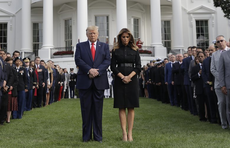 President Donald Trump and first lady Melania Trump participate in a moment of silence honoring the victims of the Sept. 11 terrorist attacks, on the South Lawn of the White House, Wednesday, Sept. 11, 2019, in Washington. (AP Photo/Evan Vucci) DCEV206 DCEV206