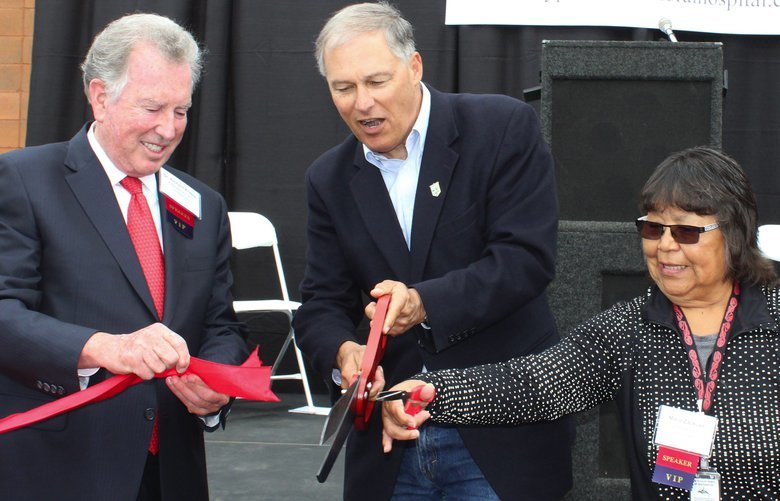 Washington State Governor Jay Inslee and Tulalip Tribes Chairwoman Marie Zackuse cut the ribbon at the Smokey Point Behavioral Hospital grand opening. 2017  ok to publish – Cara
