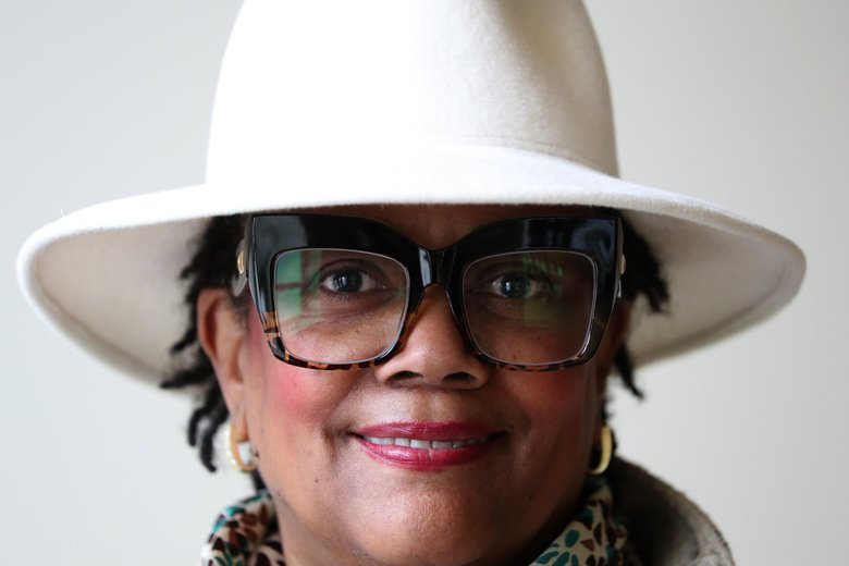 "Seattle milliner Sonia Wooten-Gill said it's all about finding one's own ""hatitude,"" choosing to wear a hat without ""embellishments"" during a hat-making demonstration for an audience at MOHAI during a Sunday Hat Parade event held in conjunction with the Black Heritage Society of Washington State. Over a dozen museum-goers wore hats to the event. (Ken Lambert / The Seattle Times)"