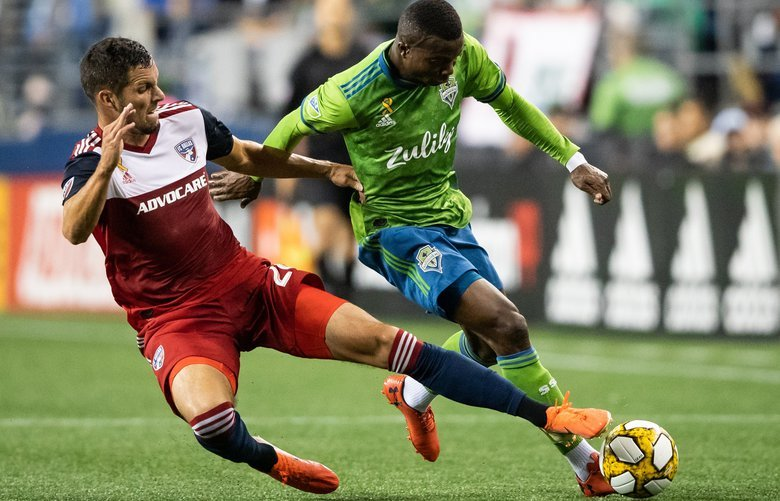 Dallas FC's Matt Hedges (24) kicks the ball out of bounds against Seattle Sounders defender Nouhou (5) during the MLS soccer game between the Seattle Sounders and Dallas FC on Sept. 18, 2019. 211519
