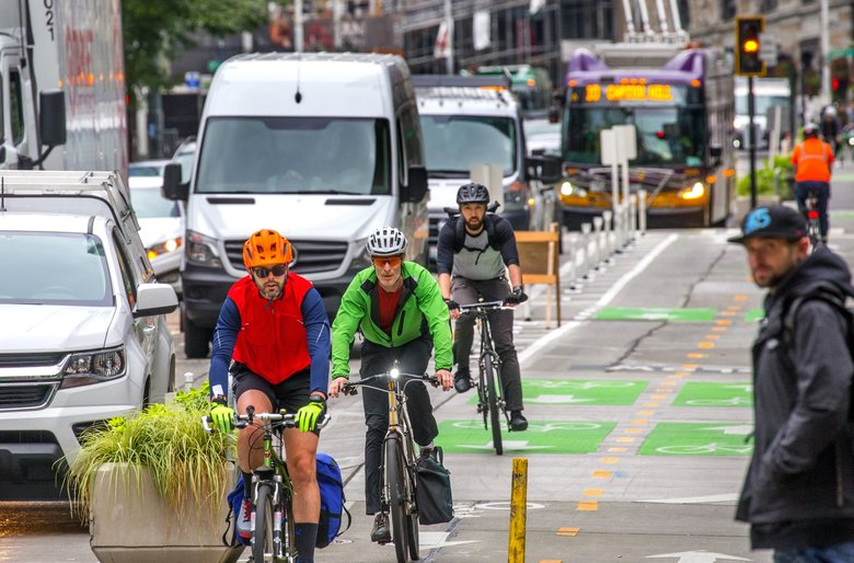 "Bicyclists travel down the protected bike lane on Second Avenue in downtown Seattle. Mayor Jenny Durkan said Monday the city should ""recommit to our goal of Vision Zero,"" the city's pledge to to end traffic fatalities and serious injuries by 2030. (Mike Siegel / The Seattle Times)"
