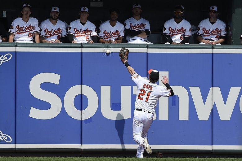 Baltimore Orioles' Austin Hays is unable to catch up with a long fly ball hit by Seattle Mariners' Shed Long in the first inning of a baseball game, Sunday, Sept. 22, 2019, in Baltimore. (AP Photo/Gail Burton) MDGB102 MDGB102 (Gail Burton / The Associated Press)
