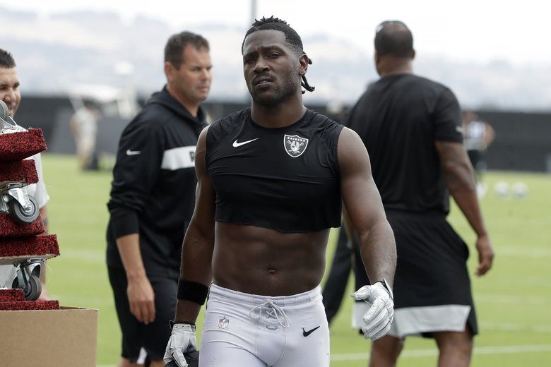 Coach Jon Gruden says star receiver Antonio Brown, pictured, is back with the team and is expected to play the season opener on Monday, after a run-in with general manager Mike Mayock put him in jeopardy of being suspended. (Jeff Chiu / The Associated Press)