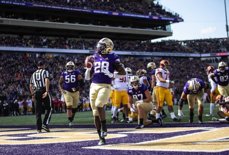 Washington's Richard Newton gets into the end zone on the 1-yard touchdown run in the 1st quarter.  The University of Southern California played the University of Washington in NCAA Football Saturday September 28, 2019 at Husky Stadium in Seattle, WA. 211622 (Dean Rutz / The Seattle Times)