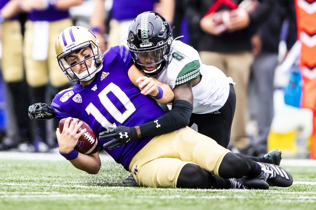 Hawaii defensive back Eugene Ford stops Washington quarterback Jacob Eason on the scramble as the University of Washington Huskies take on the Hawaii Rainbow Warriors at Husky Stadium in Seattle Saturday September 14, 2019. (Andy Bao / The Seattle Times)