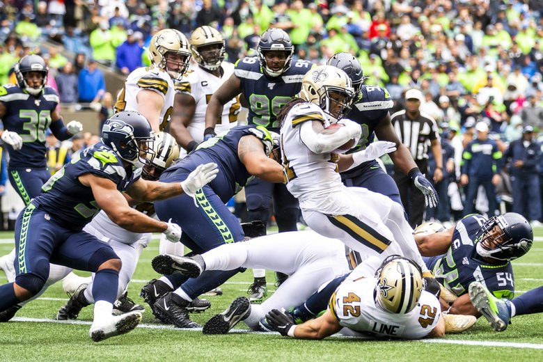 Saints running back Alvin Kamara scores a touchdown in the fourth quarter as the Seattle Seahawks take on the New Orleans Saints at CenturyLink Field in Seattle Sunday September 22, 2019.   (Andy Bao / The Seattle Times)