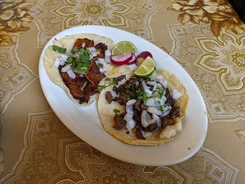 Handmade corn tortillas take these tacos to another level at Taqueria Casa Mixteca. (Jackie Varriano / The Seattle Times)