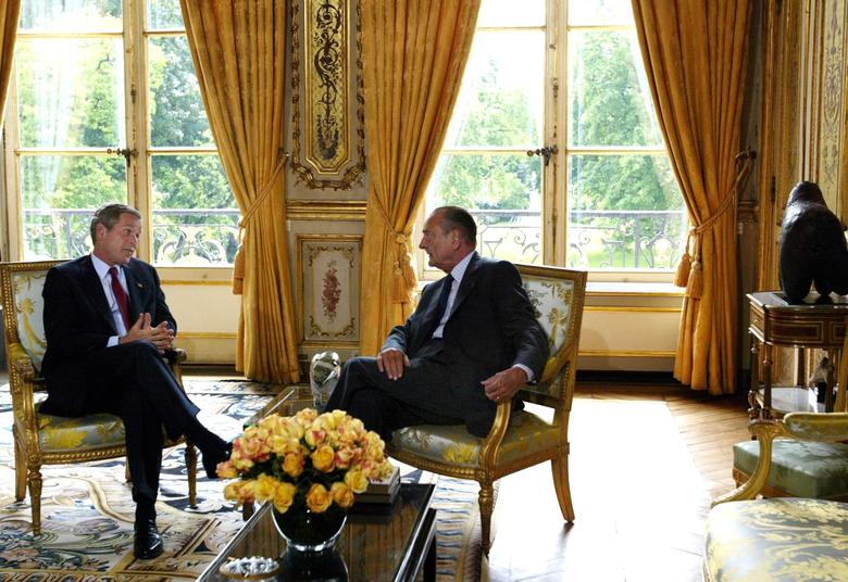 FILE– President George W. Bush and French President Jacques Chirac of France during a meeting in the president's office at Elysee Palace in Paris, May 26, 2002. Chirac, who molded the legacy of Charles de Gaulle into a personal power base that made him one of the dominant leaders of France across three decades and a vocal advocate of European unity, died on Sept. 26, 2019, at his home in Paris. He was 86. (Stephen Crowley/The New York Times)