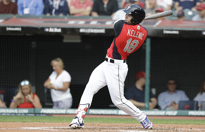 Jarred Kelenic, of the Seattle Mariners, hits during the MLB All-Star Futures baseball game, Sunday, July 7, 2019, in Cleveland. The 90th MLB baseball All-Star Game will be played Tuesday. (AP Photo/Darron Cummings)