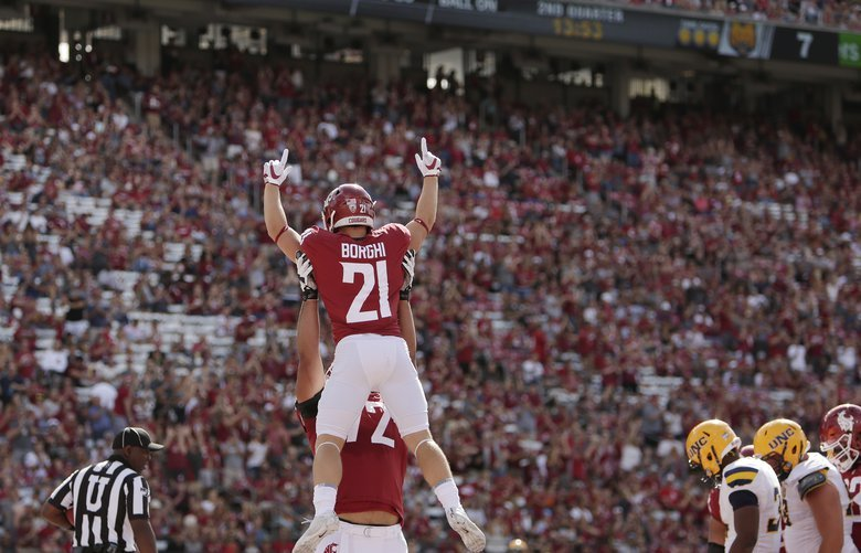 Washington State running back Max Borghi, top, celebrates his touchdown with teammate Abraham Lucas during the first half of an NCAA college football game against Northern Colorado in Pullman, Wash., Saturday, Sept. 7, 2019. (AP Photo/Young Kwak) OTK OTK