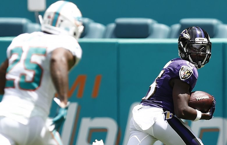 Baltimore Ravens wide receiver Marquise Brown (15) looks back as he runs in for a touchdown during an NFL football game the Miami Dolphins, Sunday, Sept. 8, 2019, in Miami Gardens, Fla. The Ravens defeated the Dolphins 59-10. (AP Photo/Brynn Anderson) FLBA101 FLBA101
