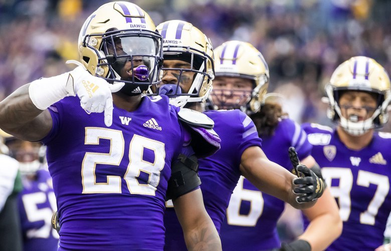 Washington running back Richard Newton celebrates his 5-yard touchdown from wildcat formation to widen the lead to 35-0 in the second quarter as the University of Washington Huskies take on the Hawaii Rainbow Warriors at Husky Stadium in Seattle Saturday September 14, 2019. 211495