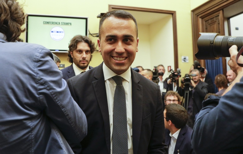 Leader of the 5-Star Movement, Luigi Di Maio, smiles as he meets the media in Rome, Tuesday, Sept. 3, 2019. Supporters of Italy's anti-establishment 5-Star Movement voted Tuesday in an online ballot and backed plan for coalition government with rival Democrats. (AP Photo/Gregorio Borgia)