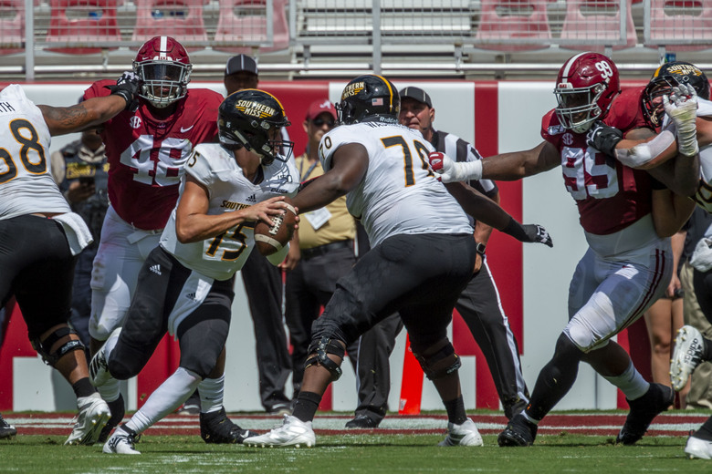 Southern Miss quarterback Jack Abraham (15) rolls out against Alabama during the first half of an NCAA college football game, Saturday, Sept. 21, 2019, in Tuscaloosa, Ala. (AP Photo/Vasha Hunt)