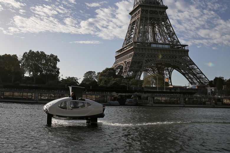 SeaBubbles co-founder Sweden's Anders Bringdal stands onboard a SeaBubble by the Eiffel Tower on the river Seine, Wednesday Sept. 18, 2019 in Paris. Paris is testing out a new form of travel – an eco-friendly bubble-shaped taxi that zips along the water, capable of whisking passengers up and down the Seine River. Dubbed Seabubbles, the vehicle is still in early stages, but proponents see it as a new model for the fast-changing landscape of urban mobility. (AP Photo/Francois Mori)