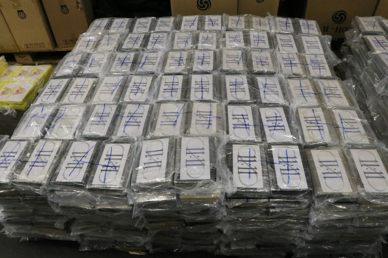 In this file handout photo from July, 2019, German customs authorities display 4.5 tons (nearly 5 U.S. tons) of cocaine seized from containers shipped to Hamburg, Germany, from Uruguay, a haul with an estimated street value of nearly 1 billion euros ($1.1 billion). The shipment was green lighted in Uruguay without inspection despite its unusual nature: It had four containers of soybeans, a much smaller quantity than a normal shipment would contain. (German Custom via AP, File)