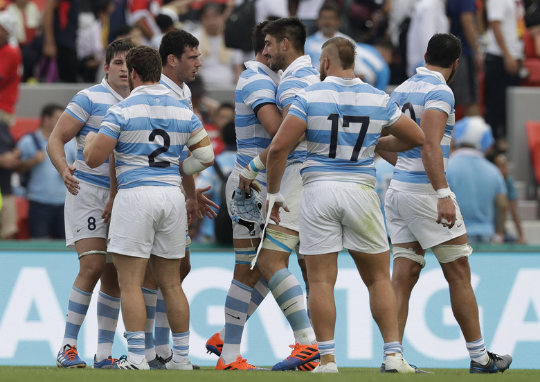 Argentina rugby team players celebrate after winning 28-12 against Tonga during the Rugby World Cup Pool C game at Hanazono Rugby Stadium in Osaka, Japan, Saturday, Sept. 28, 2019. (AP Photo/Aaron Favila)