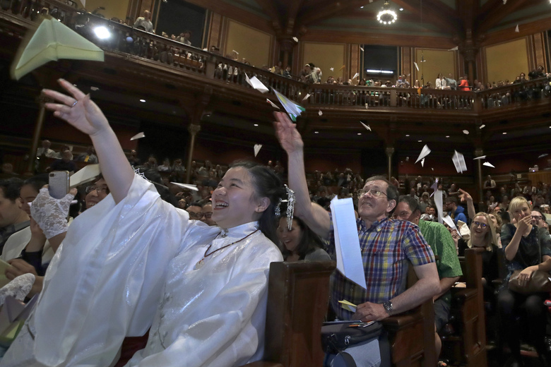 Audience members toss paper airplanes at the 29th annual Ig Nobel awards ceremony at Harvard University, Thursday, Sept. 12, 2019, in Cambridge, Mass. The spoof prizes for weird and sometimes head-scratching scientific achievement are bestowed by the Annals of Improbable Research magazine, and handed out by real Nobel laureates. (AP Photo/Elise Amendola)