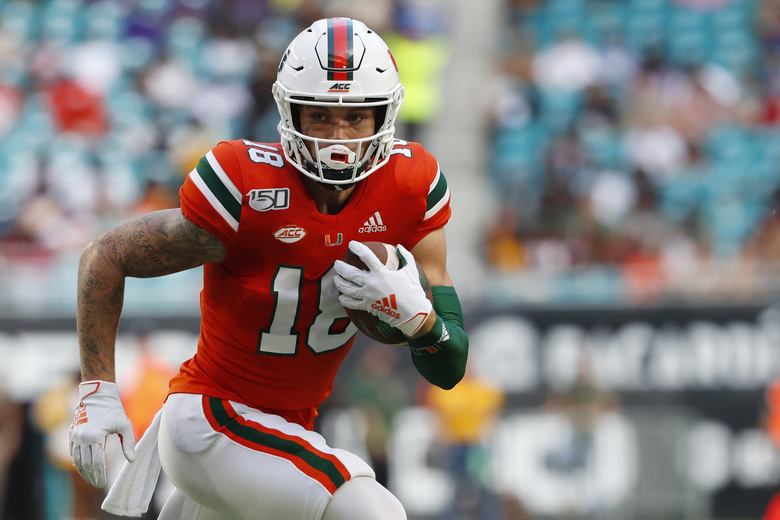 Miami quarterback Tate Martell runs for yardage during the first half of an NCAA college football game against Bethune-Cookman, Saturday, Sept. 14, 2019, in Miami Gardens, Fla. (AP Photo/Wilfredo Lee)