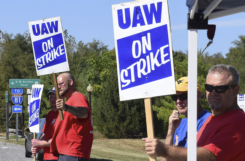 Members of United Auto Workers Local 1590 picket near the GM Martinsburg Parts Distribution Center in Martinsburg, W.Va.,, Thursday, Sept. 19, 2019, during the fourth day of a nationwide work stoppage involving about 49,000 union workers. (Matthew Umstead/The Herald-Mail via AP)