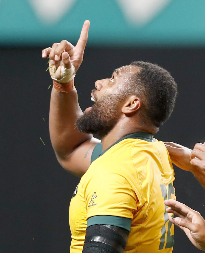 Australia's Samu Kerevi celebrates after scoring a try during the Rugby World Cup Pool D game at Sapporo Dome between Australia and Fiji in Sapporo, northern Japan, Saturday, Sept. 21, 2019. (Naoya Osato/Kyodo News via AP)