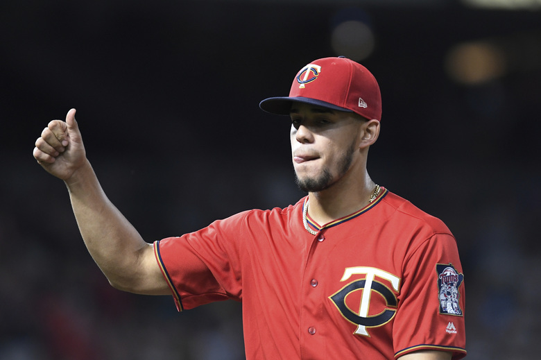 Minnesota Twins starting pitcher Jose Berrios gives a thumbs-up while leaving a baseball game with one out in the eighth inning against the Chicago White Sox, Monday, Sept. 16, 2019, in Minneapolis. (AP Photo/Tom Olmscheid)