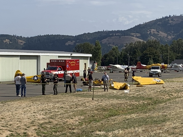 This photo provided by the Hood River County Sheriff's Department shows the wreckage of a plane that crashed shortly after takeoff at the Ken Jernstedt Airfield near Hood River, Ore. on Friday, Sept. 6, 2019. As dozens of horrified pilots and other aviation enthusiasts looked on, the small plane took off Friday from an airfield in the scenic Oregon town of Hood River then plummeted to the ground after its engine cut out, killing the pilot and his passenger. (Deputy Joel Ives/Hood River County Sheriff's Department via AP)