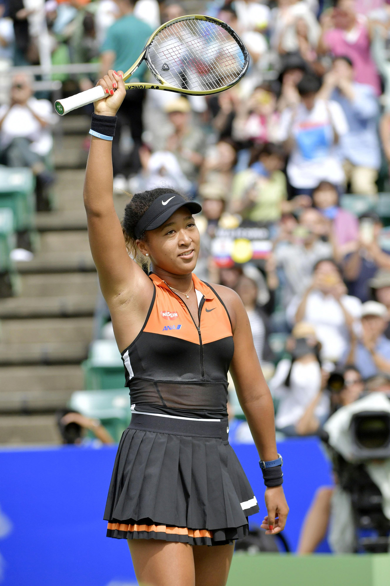 Japan's Naomi Osaka acknowledges cheering of the crowd after winning the Toray Pan Pacific Open tennis tournament in Osaka, western Japan, Sunday, Sept. 22, 2019. Osaka won her first singles title since the Australian Open in January by beating Russia's Anastasia Pavlyuchenkova 6-2, 6-3 in the final. (Kyodo News via AP)