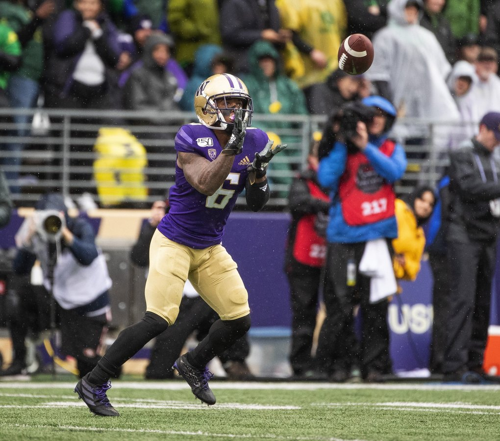 Chico McClatcher takes the lob pass from Aaron Fuller on the kickoff, but the gain is wiped out by unsportsmanlike foul called against McClatcher.  The 12th-ranked Oregon Ducks played the 25th-ranked Washington Huskies Friday, October 18, 2019 at Husky Stadium in Seattle, WA. (Dean Rutz / The Seattle Times)