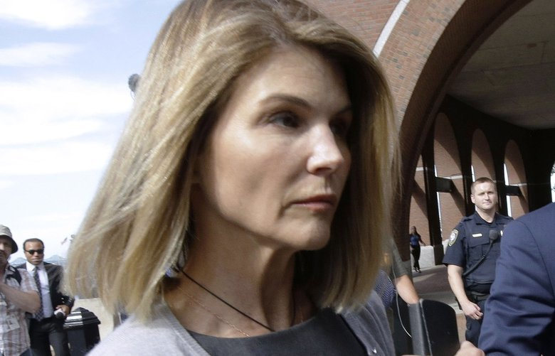 FILE – In this Aug. 27, 2019 file photo, actress Lori Loughlin departs federal court in Boston after a hearing in a nationwide college admissions bribery scandal.  Loughlin, her fashion designer husband, Mossimo Giannulli, and nine other parents face new charges in the college admissions scandal. Federal prosecutors announced Tuesday, Oct. 22, 2019, that the parents were indicted on charges of conspiracy to commit federal program bribery.  (AP Photo/Steven Senne, File) BX301 BX301
