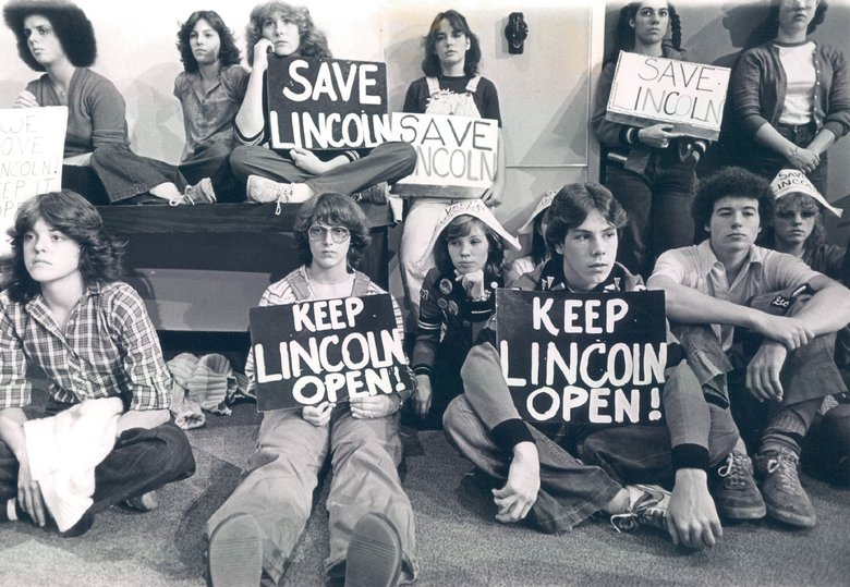 Lincoln High School students, armed with signs protesting the proposed closure of the school, waited without much interest as the Seattle School Board dealt with other matters at this meeting.  (Ann E. Yow / The Seattle Times, 1980)