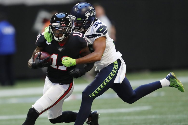 Seattle Seahawks cornerback Akeem King (36) tackles Atlanta Falcons wide receiver Julio Jones (11) during the second half of an NFL football game, Sunday, Oct. 27, 2019, in Atlanta. (John Bazemore / The Associated Press)