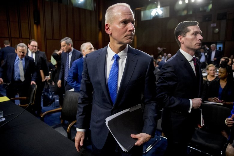 Boeing President and Chief Executive Officer Dennis Muilenburg leaves after testifying before a Senate Transportation Committee hearing on Tuesday.  (Andrew Harnik / The Associated Press)