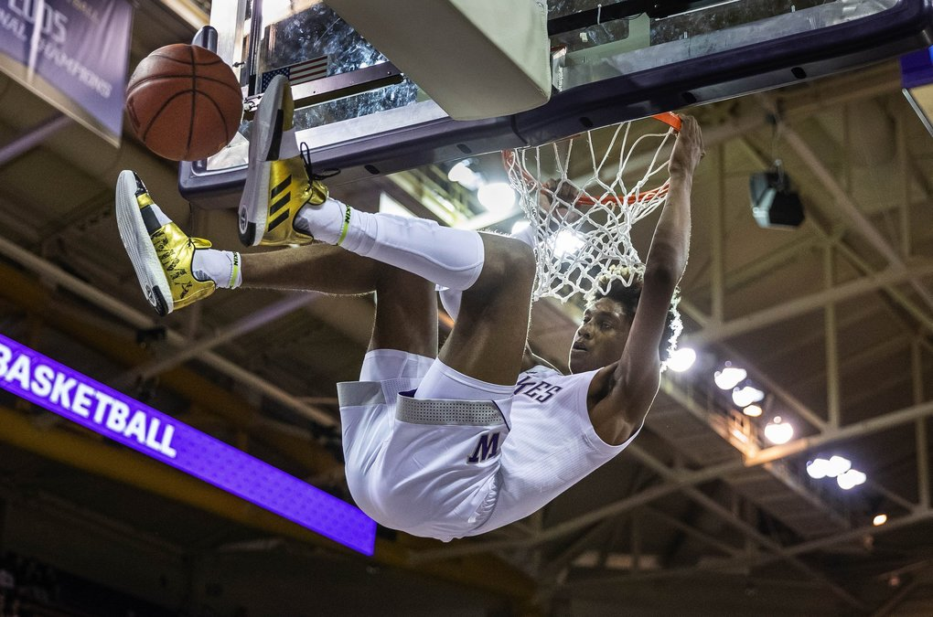 Jaden McDaniel's emphatic jam gave the Huskies a 43-23 lead over Western Washington with 32 seconds to play in the 1st half.  Western Washington University Vikings played the Washington Huskies in NCAA Exhibition basketball Thursday, October 31, 2019 at Alaska Airlines Arena in Seattle, WA. (Dean Rutz / The Seattle Times)